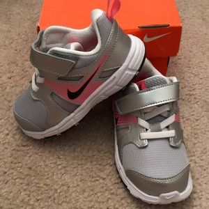 Toddler silver and pink nike shoes